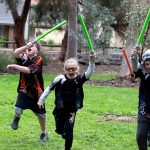 Kids running with light sabers