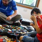 kids building with Lego