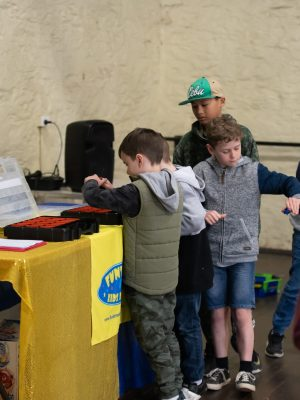 Kids picking from great selection of beyblade